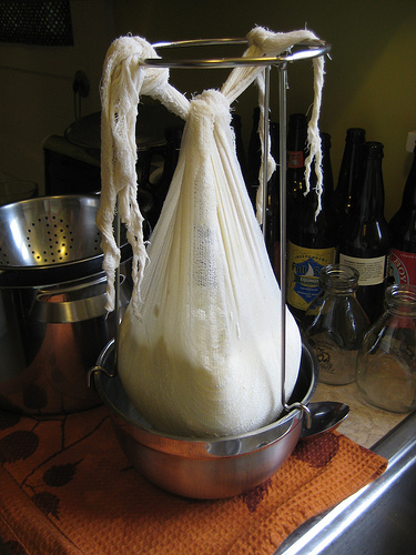 Hanging curds with a jam strainer